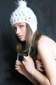 Young girl in white cap — Stock Photo