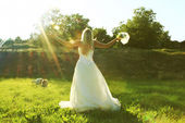 Bride on the background o with a wedding bouquet — Stock Photo