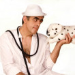 Man in a white hat with toy dogs Dalmatians — Stock Photo