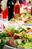 Table with dinner — Stock Photo