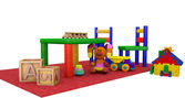 Kindergaten play toys on a red mat — Stock Photo