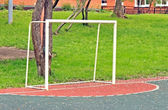 The football goals on the children playing field — Stock Photo