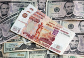 Photo of two currencies - US Dollar and rouble — Stock Photo