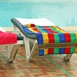 Relax chairs near pool with towels — Stock Photo #11618105