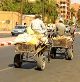 An arabian man driving a donkey — Stock Photo