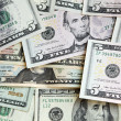 Stock Photo: Heap of US dollars, notes of different values, money background