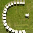 Lecture symbolized by chairs arranged in half circle — Stock Photo #11341275