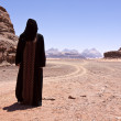 Nomadic woman with burka in the desert — Stock Photo #11341425