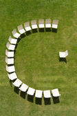 Lecture symbolized by chairs arranged in a half circle — Stock Photo