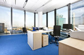 Modern business office with panoramic cityscape — Stock Photo