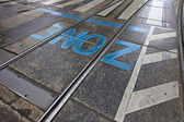 Zone - asphalt surface with rails — Stock Photo