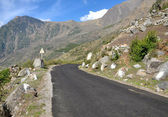 Long curving road in mountains — Stock Photo