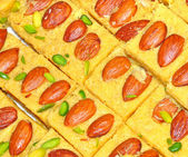 Indian sweets studded with almond — Stock Photo
