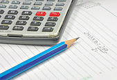 Assembled calculator, pencil and note book — Stock Photo