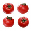 Red wet tomatoes on a white background - Stock Photo