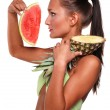 Exotic girl with fruit — Stock Photo
