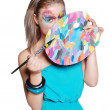 Cute happy girl with colored palette and brushes - Stock Photo