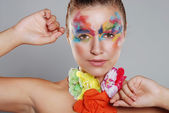 Beautiful young woman with painted makeup — Stock Photo
