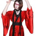 Beautiful young geisha girl in kimono with sword — Stock Photo #12070142
