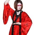 Beautiful young geisha girl in kimono with sword — Stock Photo #12070149