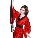 Beautiful young geisha girl in kimono with sword — Stock Photo #12070159