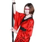 Beautiful young geisha girl in kimono with sword — Stock Photo #12070162