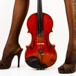 Royalty-Free Stock Photo: Beautiful legs with violin.