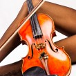 Tired young woman with violin. — Stock Photo