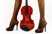 Beautiful legs with violin. — Stock Photo