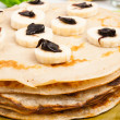 Stock Photo: Pancakes with bananand chocolate cream
