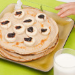 Pancakes with banana and chocolate cream — Stock Photo