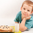 Boy and pancakes — Stock Photo