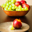 Fresh fruits in bowl — Stock Photo