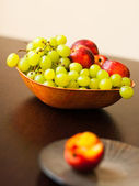 Colorful fruits in bowl — Stock Photo