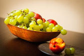 Sweet fruits in bowl on table — Stock Photo