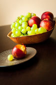Fresh fruits in bowl on table — Stock Photo