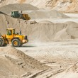 Working machines at gravel pit - Stock Photo