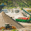 Conveyor belt at gravel heap - Stock Photo