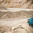 Truck working at gravel pit - Stock Photo