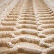 Stock Photo: Wheel tracks on dirt