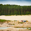 Working day at gravel pit - Stock Photo