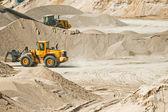 Working machines at gravel pit — Stock Photo
