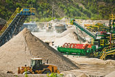Conveyor belt at gravel heap — Stock Photo