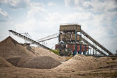 Mining belts are sorting sand — Stock Photo