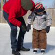 Father teaching son how to ice skate — Stock Photo #11113109