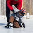Father teaching son how to ice skate — Stock Photo #11114023