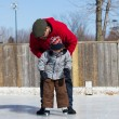 Father teaching son how to ice skate — Stock Photo #11114141