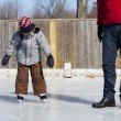 Royalty-Free Stock Photo: Father teaching son how to ice skate