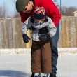 Father teaching son how to ice skate — Stock Photo #11114672