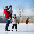 Happy family at the skating rink — Stock Photo #11115248